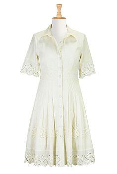 Our cotton poplin shirtdress is updated with floral eyelet trim at the elbow length sleeves, banded waist and tiered hem.