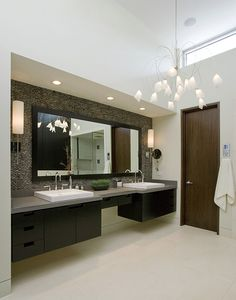 Lowered ceiling over sink.  Raised ceiling with high window for natural light.