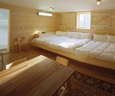 bedrooms-light-wood-white-beds-bedspreads-wood-walls