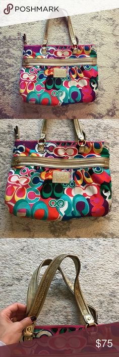 Colorful gold trimmed Coach Poppy canvas tote bag Colorful (orange, purple, white, blue, pink, black, green, etc.) medium-sized canvas Coach Poppy tote bag / shoulder purse. The bag has gold leather trimming, and gold leather straps with gold sequins on them. The bag measures 14 inches by 17.5 inches by 4 inches, and has a strap drop length of 8 inches. Top zip enclosure and an exterior zippered pocket. The interior is lined with a purple silk fabric, and has an interior zippered pocket and…