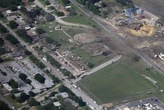 This Thursday, April 18, 2013 aerial photo shows the remains of a nursing home, left, apartment complex, center, and fertilizer plant, right, destroyed by an explosion in West, Texas.