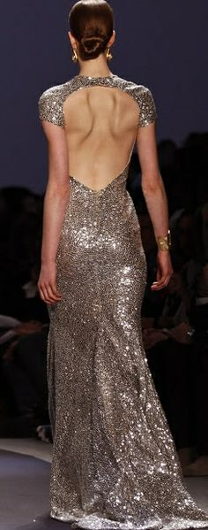 One of the wedding dresses I designed was like this , but with long sleeves. It was a silver sparkled fabric, as well, but the open back carried down dangerously lower.
