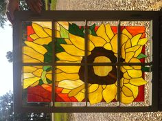 stain glass sunflower in and old window