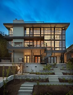 Janof Hald Architecture    Amazing modern Seattle home exterior - love the idea of big contemporary steel windows on the back of a traditional house