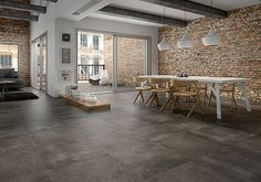 Cement effect tiles (but we're looking for a lighter hue) --- New york loft with tiles on the floor - Tile Trends - The Coverings in Atlanta 2013 Wall Tiles Design, Floor Design, House Design, Brick Design, New Yorker Loft, Loft Industrial, Industrial Design, Industrial Flooring, Loft Stil