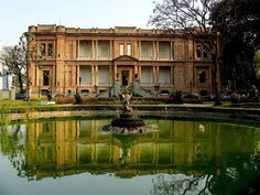 The back of Pinacoteca do Estado, one of the best Brazilian Art Museums in the country, is integrated with Jardim da Luz, the first public park in Sao Paulo, Brazil