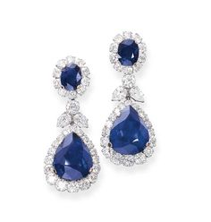 A PAIR OF SAPPHIRE AND DIAMOND EAR PENDANTS, BY BULGARI   Each set with a pear-shaped sapphire within a brilliant-cut diamond border to the foliate diamond link and sapphire and diamond cluster surmount, mounted in platinum, 5.2 cm long  Signed Bulgari