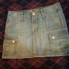 Denim Skirt Old Navy women's ultra low waist denim skirt. Light denim with distressed details and white buttons. Worn very little. Old Navy Skirts Mini