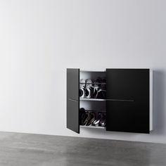 Czarna szafka na buty, meble do korytarza i przedpokoju. Zobacz więcej na: https://www.homify.pl/katalogi-inspiracji/13055/urzadzanie-korytarza-szafki-na-buty