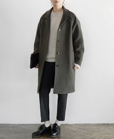 grey sweater, navy/black bottoms, white socks, black oxfords, grey coat