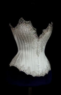 bbf4fb61bf Silver Beaded Corset Couture Wedding Corsets and Gowns. it looks gorgeous