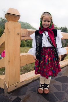 A young girl wearing a traditional costume during the celebration of August 15th in the Monastery of Barsana, Maramures.