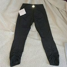 Make an offer! NWT Beyond Yoga Back crop leggings Dark Heather grey. Still in plastic wrapping with tags. See my other post of the same leggings for more pics! Super soft, I prefer BY to Lulu because of their softness. lululemon athletica Pants Leggings