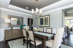 Dark gray dining room dining room traditional with white crown molding open dining