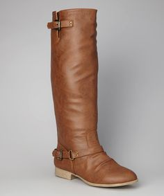 An ever-so stylish equestrian aesthetic fuses with street chic in this pair that flaunts buckle accents atop a slim and fitted shaft.1.5'' heel15'' shaft15'' circumferenceBack zipper closureMan-madeImported