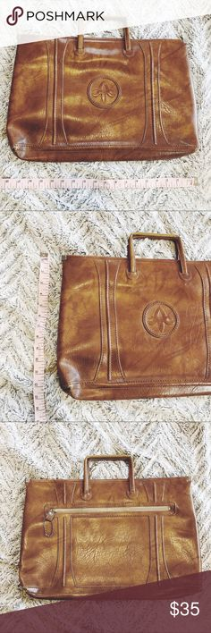 Vintage American Tourister Leather Bag Amazing quality leather travel bag by American Tourister (American Luggage Works). Vintage 1975 label inside bag. Some wear on handles and bottom corners (see images), but overall great sturdy vintage bag 😍  See images with measuring tape for size references! American Tourister Bags