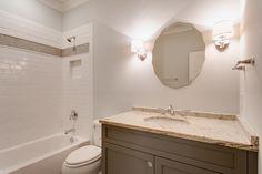 tile insert matching the vanity Rivertowne Home in Mount Pleasant, SC by JacksonBuilt Custom Homes