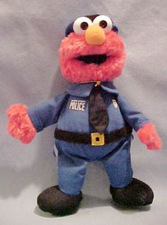 Gund Sesame Street Plush Police Officer Elmo - made from a soft plush fabric Elmo is made.  He looks adorable in his Policeman Uniform, a great way to promote imagination!  8 inches