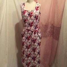Purple floral sleeveless sun dress belted knee Knee length purple floral sleeveless dress. Approximate measurements waist 29 inches  hips 38 inches. Length from shoulder seem to bottom 40 inches B moss Dresses Midi