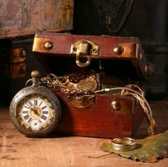 Mens antique jewelry and watch in a leather jewelry box
