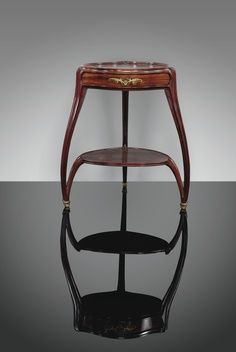 Louis Majorelle (French, 1859–1926), Nancy, Mahogany and Gilt Bronze Table.