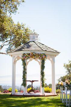 Beautiful floral gazebo wedding ceremony decor! | Offbeat Bride