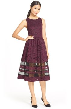 Walking the line between demure and risqué in this floral lace fit-and-flare dress with sheer panels.