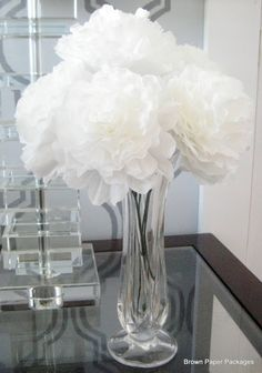 How to make pretty paper peonies out of coffee filters. Would be cute as a table centerpiece.
