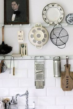 vintage kitchen tools hung on wood pegs. / sfgirlbybay