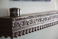 Indian Carved Mantle -- photograph by Giannetti Home Design