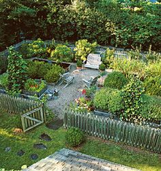 Raised bed garden with picket fence