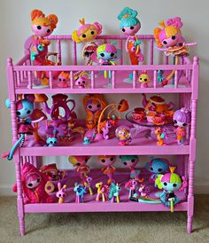 Desi and her daughters painted these shelves to create this ab-sew-lutely adorable display for their Lala-Oopsies! #Lalaloopsy #LalaOopsies #DIY #whimsical #dolldisplay #shelves