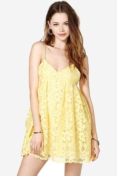 Soak up sun in this adorable yellow babydoll dress featuring lace detailing and adjustable should...