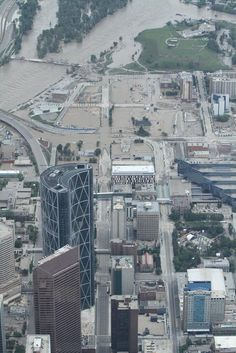"""East end of downtown entirely under waters. Natural Disasters, Calgary, City Photo, Nostalgia, June, Bow, Canada, River, History"