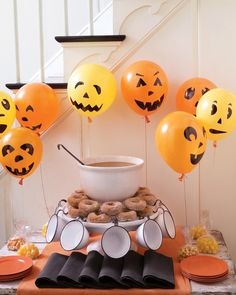 A gaggle of helium-filled jack-o'-lantern balloons hovers near the refreshment table. The simple features are drawn onto the inflated balloons with permanent marker. Choose an assortment of geometric shapes that are easy to create freehand.