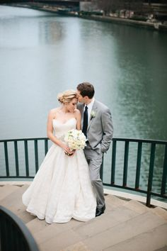 CHICAGO RIVER. Beautiful photo opportunities! This one is on the winding staircase at 401 N. Michigan Avenue (Pioneer Court). Wedding photos; wedding photography; wedding photo ideas; Chicago wedding photography locations. #WeddingPhotos #WeddingPhotography