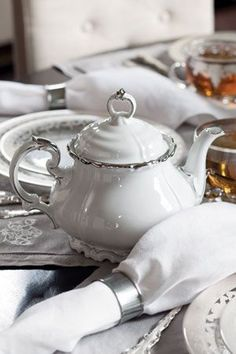 White teapot with silver trim