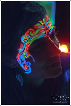 Art by Lana Chromium, face painting in UV colors, Blacklight paint, event make up, creative make up, face art, San Diego, Los Angeles, glow in the dark