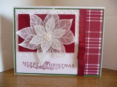 Joyful Christmas by Stampin' Up!. I stamped the poinsettia onto vellum and embossed with a mix of craft white and iridescent ice embossing powders.