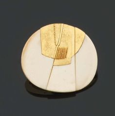 By Othemar Zschaler. 1970. Ivory, plated gold.