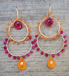 "Bold, colorful and fun! These earrings feature carnelian stones, pink tourmaline quartz (top center), ruby red quartz and orange quartz wrapped in 14k gold fill wire.Length is 3""."