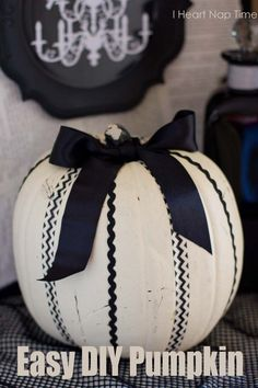 Easy DIY pumpkin on iheartnaptime.net . It's made with washi tape, ric rac and ribbon! This is absolutely gorgeous!
