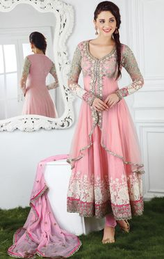 Rose pink churidar kameez with dupatta.     Work - Heavy zari embroidery, resham, floral embroidery, lace and floral embroidery.     Fabric - Net.     Some ethereal beings are not restrained by time and embellish their charm in true splendor which spans across the ages.     Matching bottom and dupatta comes with this.