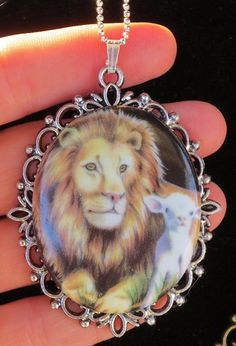 The Lion and the Lamb Porcelain Pendant Necklace ~ And There Was Peace On Earth!  This beautiful handmade porcelain cameo is set on a antique silver bezel pendant.  Comes on a sterling silver bead bal