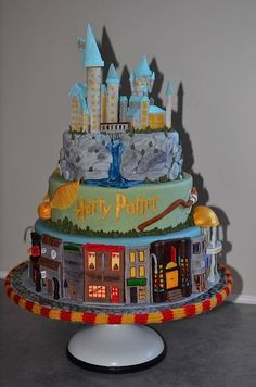 Cake Wrecks - Home - Sunday Sweets: The Wizards ofAhhhh    Don't you love the cobblestones on the cake stand and the Gryffindor scarf edging?