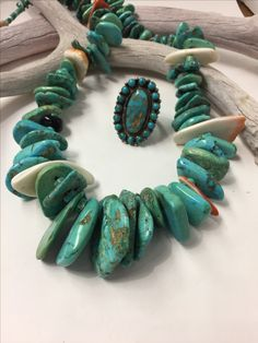 Vintage American turquoise Pueblo beads with Zuni ring......