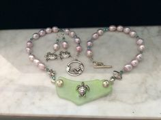 A personal favorite from my Etsy shop https://www.etsy.com/listing/464055917/necklace-set-seaglass-pearls-swarovski