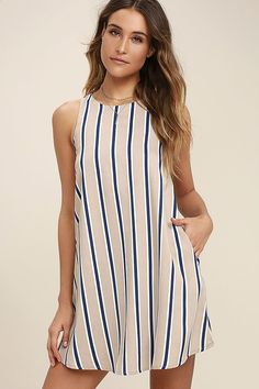 Lulus Exclusive! Your styling options are limitless with the Broad Horizons Beige Striped Shift Dress! Beige, white, and navy blue striped print woven poly forms a sleeveless, shift bodice with side seam pockets. Back keyhole with top button.
