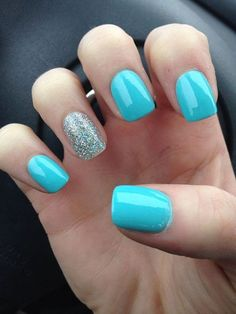 Two tone nails are very popular nowadays. You must have seen many models and celebrities show off beautiful manicured nails with the coolest two tone nail designs on them. As the name suggests, two tone nails art means that the wearer uses two differ Light Blue Nails, Blue Glitter Nails, Blue Acrylic Nails, Acrylic Colors, Silver Glitter, Turqoise Nails, Blue And Silver Nails, Glitter Art, Sparkle Nails