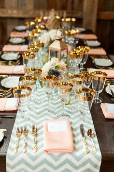 love the gold glasses and the colors. Mint chevron runner and peach linen napkins with gold flatware and gold rimmed glass make a fabulous tablescape setting.